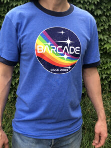 T-shirt with Barcade Printed on it and a Rainbow in Space Graphic